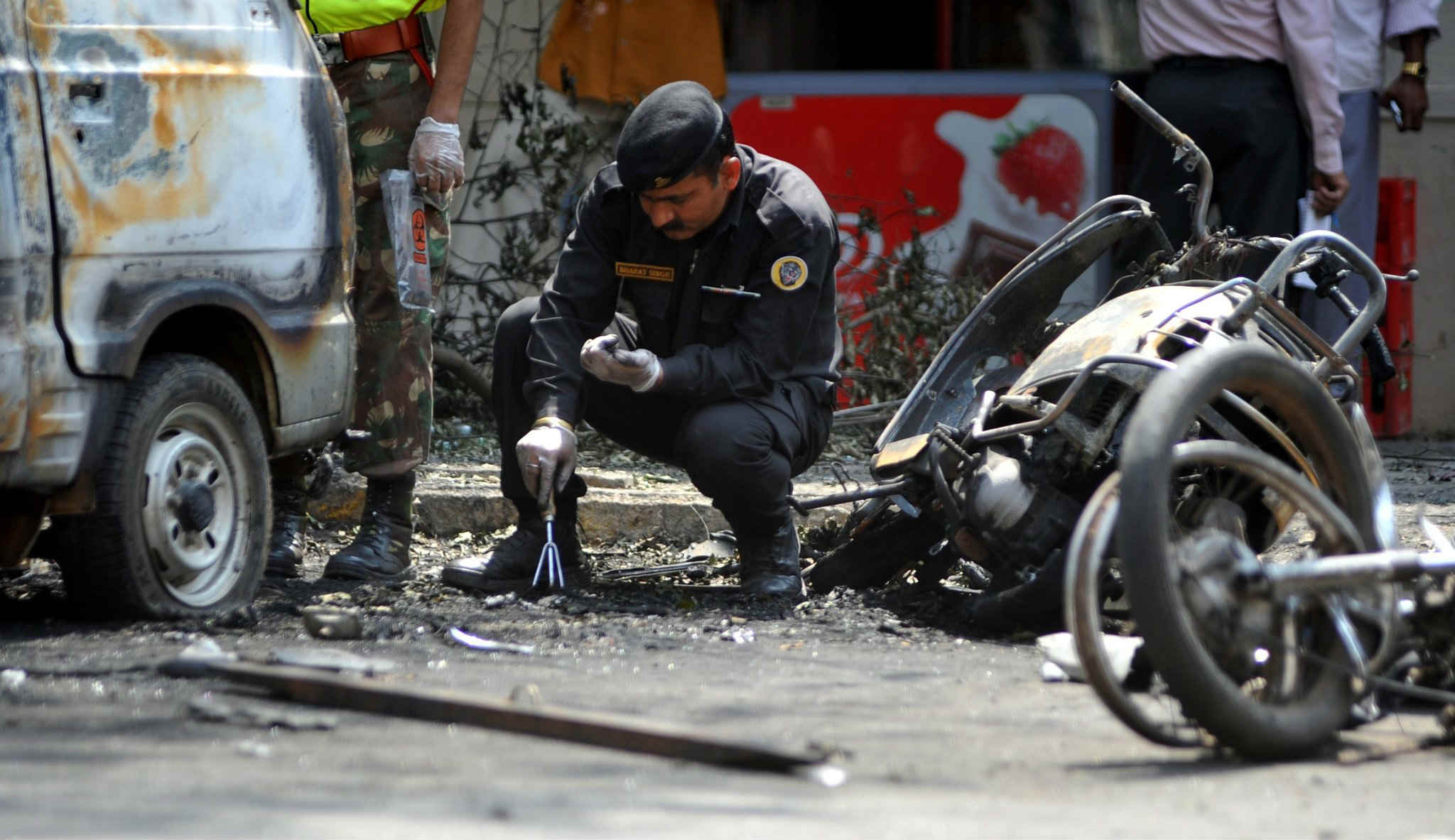 police checking traces of bomb blasts