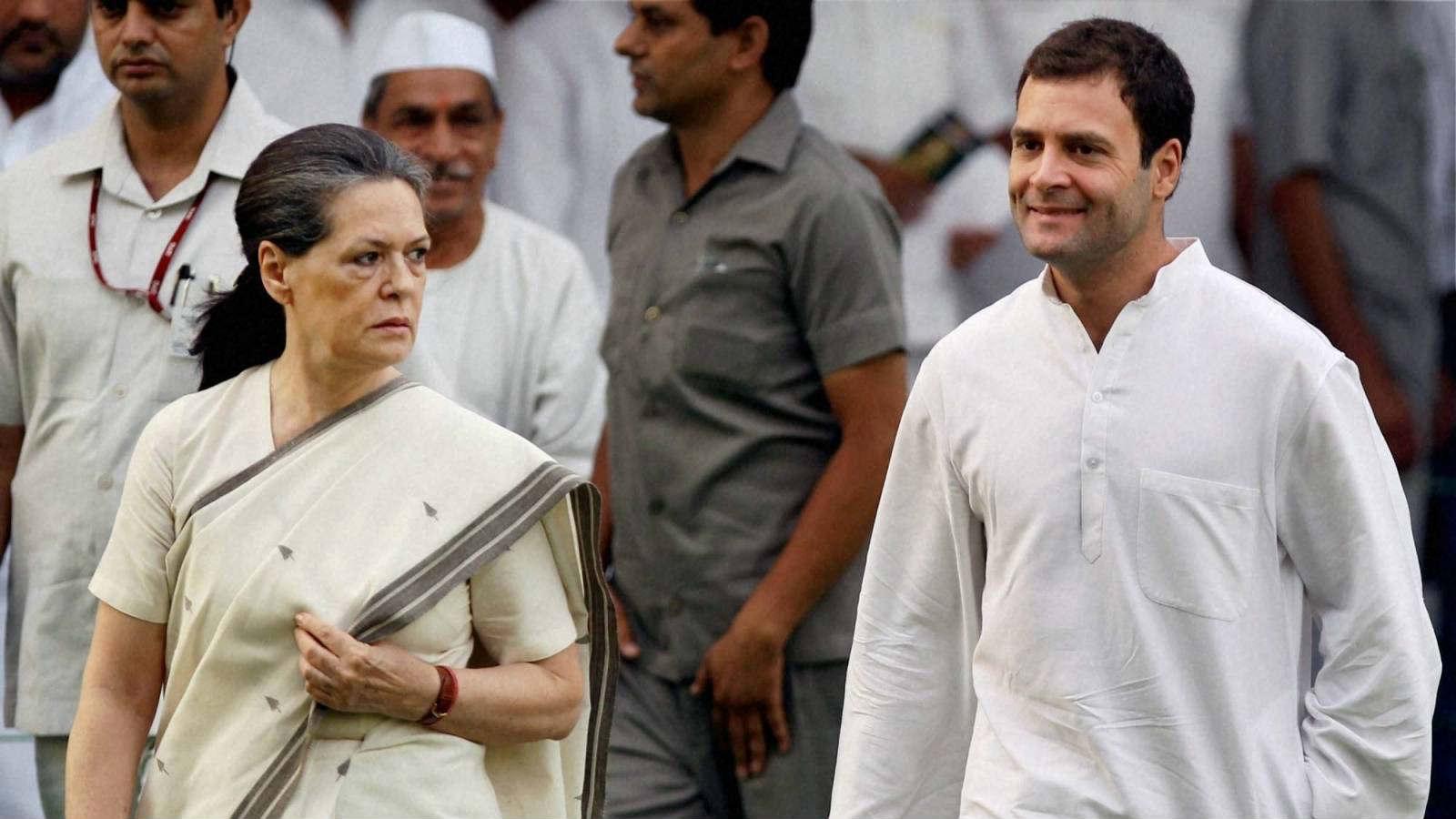 Sonia Gandhi and Rahul Gandhi instructing party members