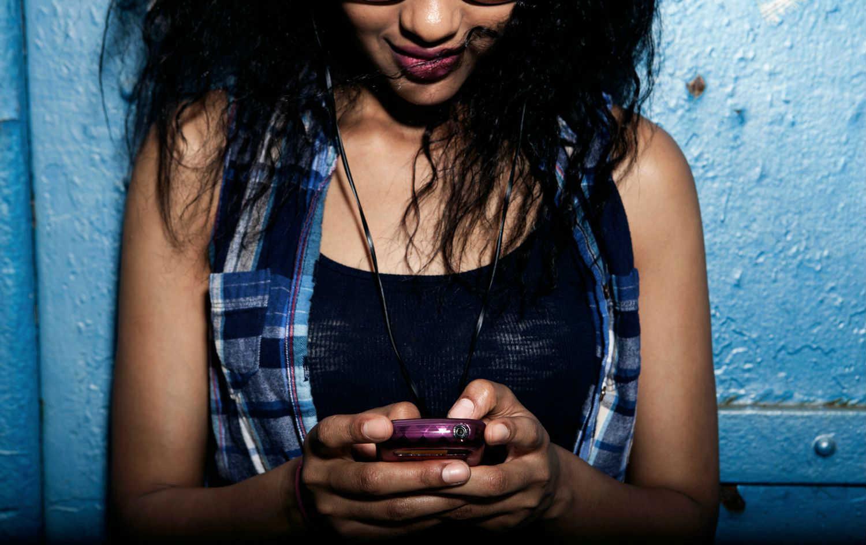 a girl sending text messsage