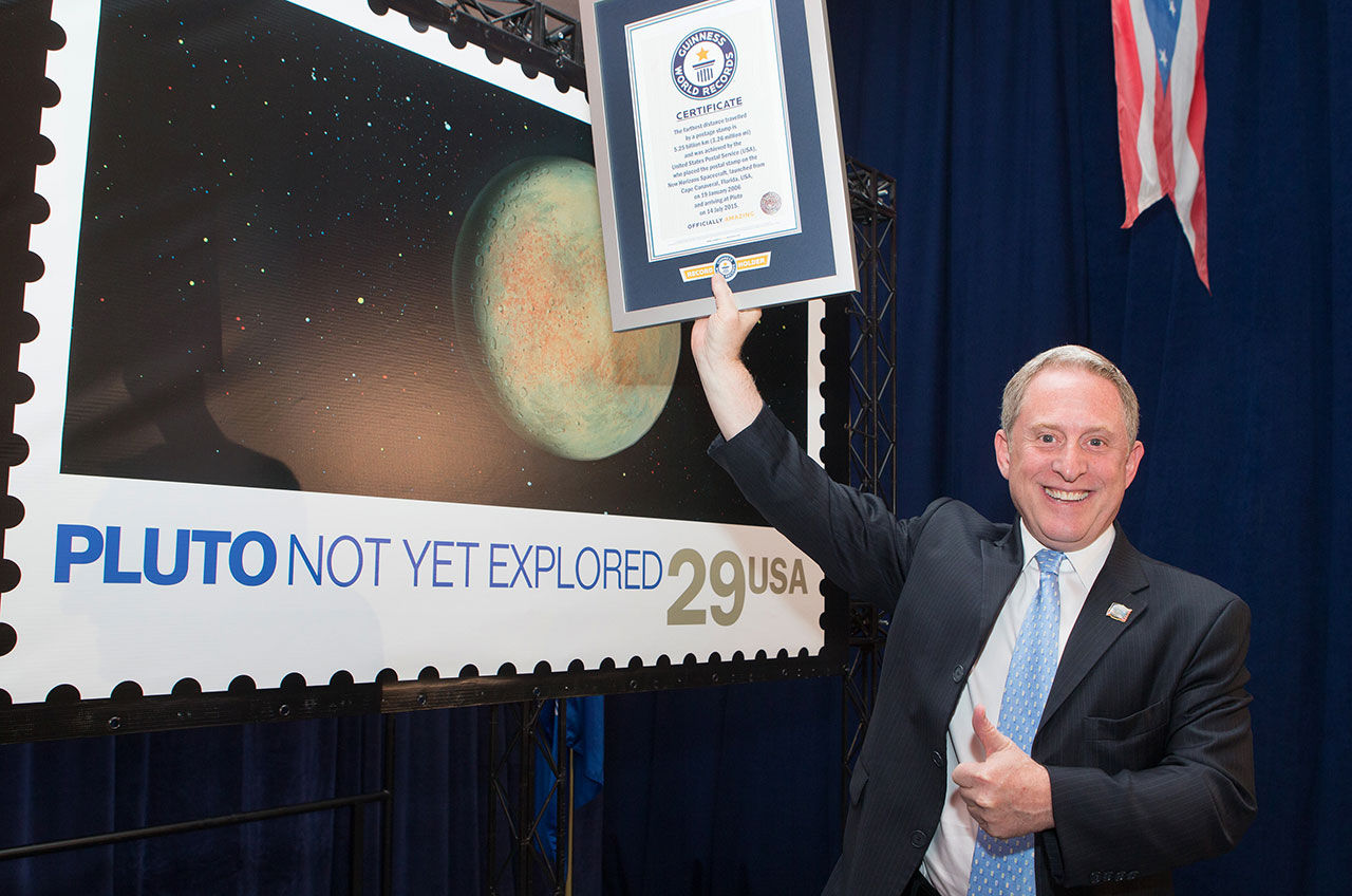 See Pic: NASA sets world record by sending Pluto Stamp on New Horizons
